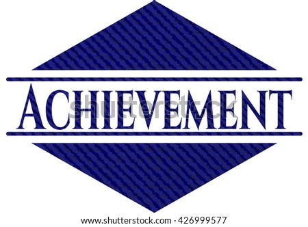 Achievement badge with denim background
