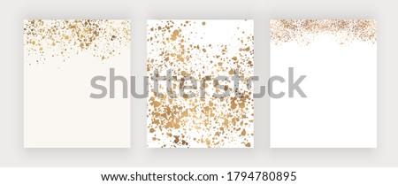 Acrylic gold splash spot blotch on white background