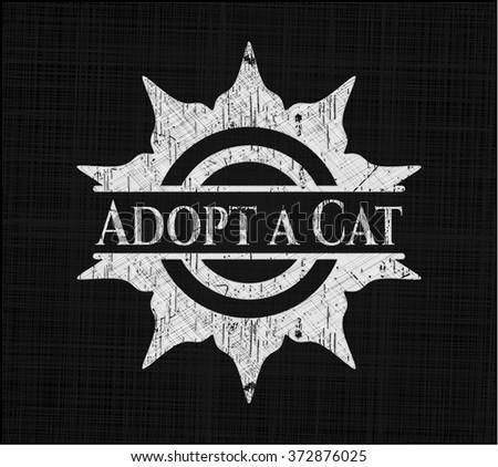 Adopt a Cat chalk emblem written on a blackboard