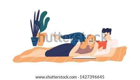 adorable couple lying on bed