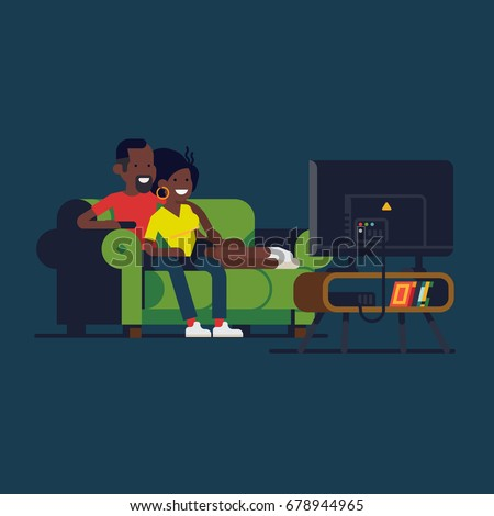 african couple watching tv