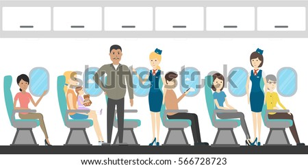 Airplane economy class interior. Flying attendants and passengers.