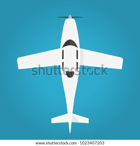 Airplane in the air top view. Flying an airplane with a shadows. Airplane with propeller view from above isolated from the background. Simple design. Flat style realistic vector illustration.