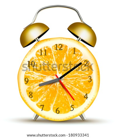 alarm clock made of an orange