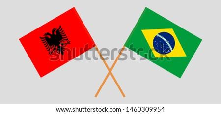 Albania and Brazil. Crossed Albanian and Brazilian flags