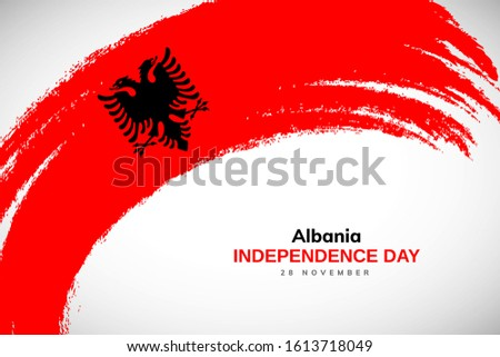 Albania flag made in watercolor brush stroke background. Independence day of Albania. Creative Albania national country flag icon. Abstract watercolor painted grunge brush flag background.