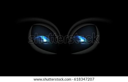 alien eyes on a black