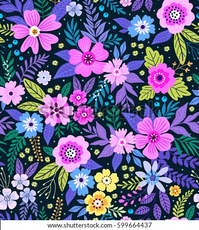 Amazing seamless floral pattern with bright colorful flowers  and leaves on a blue background. The elegant the template for fashion prints. Modern floral background. Folk style.