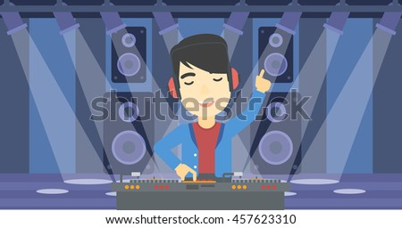 an asian young dj mixing music