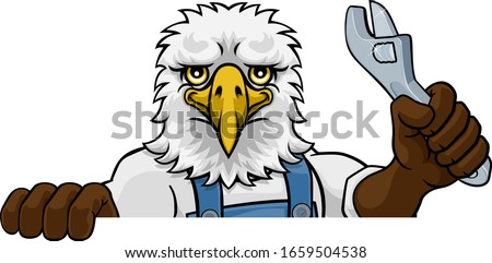 An eagle cartoon animal mascot plumber, mechanic or handyman builder construction maintenance contractor peeking around a sign holding a spanner or wrench