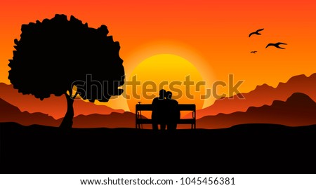 An elderly couple sitting on a bench in a mountainous area, next to a large tree. Look at the beautiful sunset.