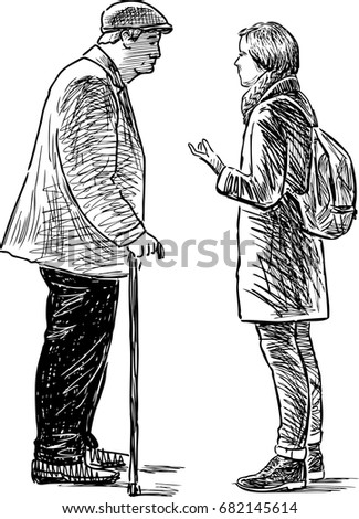 An elderly man and young girl are talking