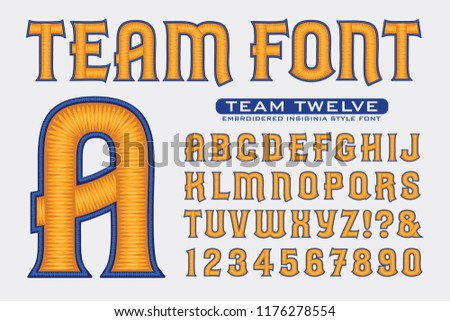 An embroidery-style alphabet in blue and yellow on a white background. This font is ideal for sports team style logos or insignias, as seen on caps and letter jackets.