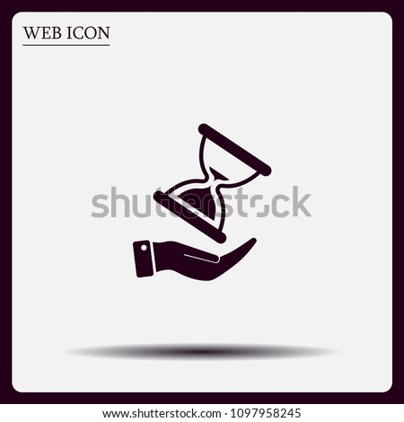 An hourglass on the hand. Vector icon.