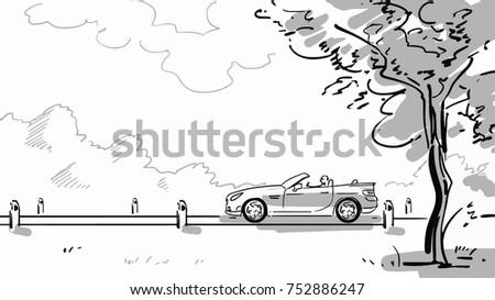 an open top car rides along a