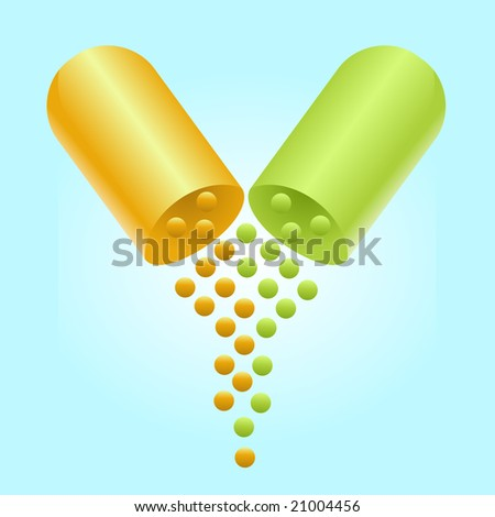 An orange and green pill is split in half and particles are coming out of it.