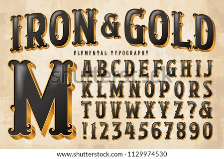 An ornate antique styled alphabet with gilded edges and black interior