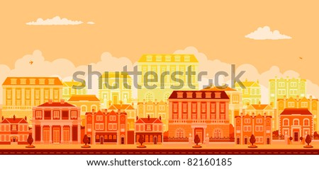 An urban tree lined avenue with smart townhouses in oranges, yellows and reds
