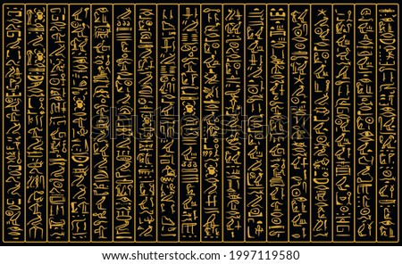 Ancient golden egyptian hieroglyphs alphabet pattern over black background. Ancient egyptian and ancient culture concept