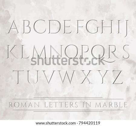 ancient roman letters chiseled