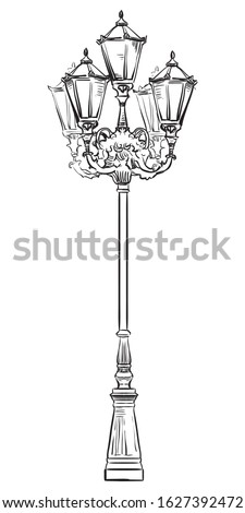 Ancient street lamp in classic style with decorative elements. Vector hand drawing illustration in black color isolated on white background