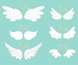 Angel wings with gold nimbus. Cartoon vector icons set isolated on background.