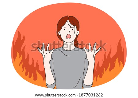 Anger, evil, furious woman concept. Young angry furious female cartoon character standing with fingers out and expressing rage and anger over burning fire at background vector illustration  Foto stock ©