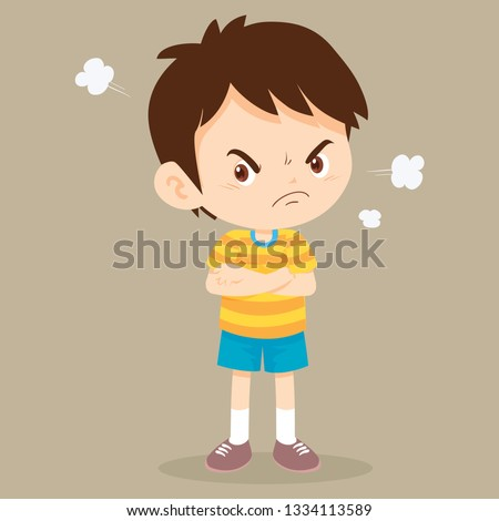angry boy actions.Angry child standing in a pose, arms crossed, with a disgruntled look on him face.bullying children.