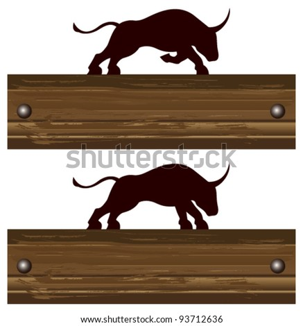 angry bull with wood banner