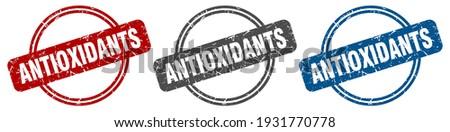 antioxidants round isolated label sign. antioxidants stamp