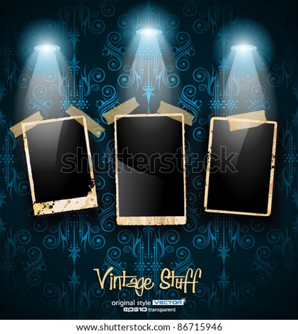 Antique distressed photoframes with old dirty look on a vintage seamless wallpaper. Frames are featured by led spotlights.Shadows are transparent.