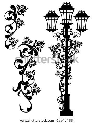 antique street light among rose ...
