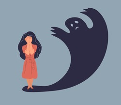 Anxiety or panic attack. Sad young woman with lowered head frightened with his own shadow and having panic disorder. Psychology, solitude, fear or mental health problems concept. Depressed sad person