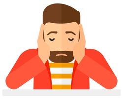 Anxious man clutching his head.