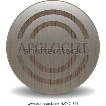 Apologize badge with wood background