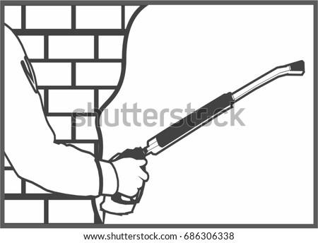 Applying gypsum plaster to a brick wall with a spray plastering machine
