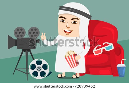 Arab Boy or Man watching movie in a Cinema or Theater. Excited about new released film. Saudi Government has lifted the ban off cinemas in country for entertainment.
