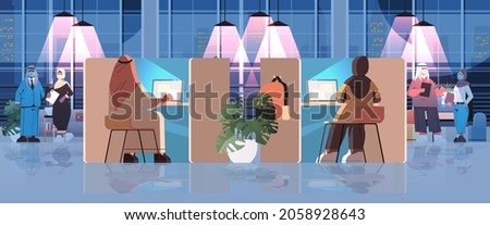 arab businesspeople in masks working in creative coworking center business meeting teamwork concept Photo stock ©