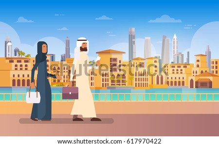 arab couple walking dubai