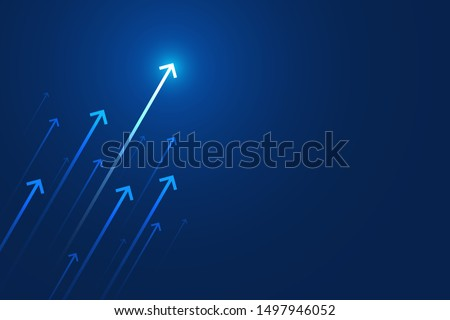 Arrow up on blue background, copy space composition, business growth concept.