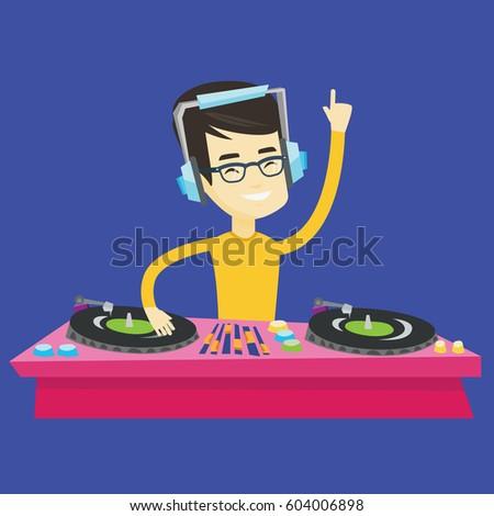 asian dj in headphones at the