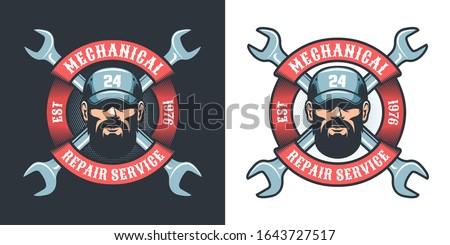 Auto Mechanic with wrench and ribbon - retro logo. Repair man in cap - retro emblem. Vector illustration. Stock photo ©