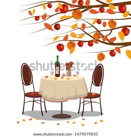 autumn cafe table with wine for