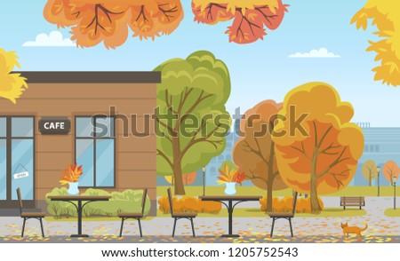 autumn city park with tables