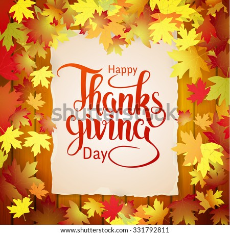 Autumn holiday Thanksgiving day background, lettering on the wood background and falling leaves