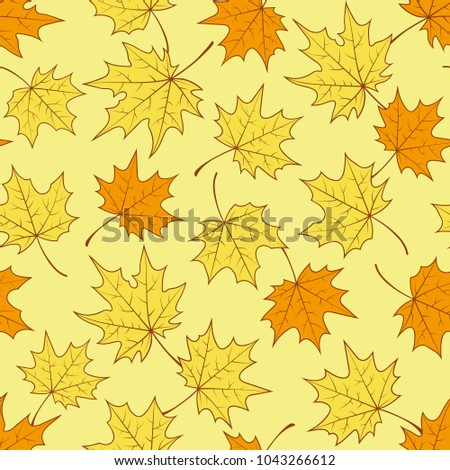 autumn maple leaves on a yellow