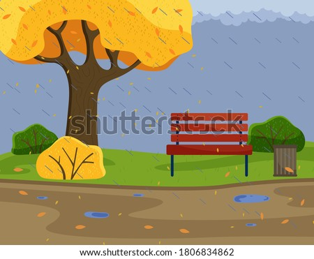 Autumn park background view with strong rain, cold damp weather, scene with bench, yellow tree and bushes, trash bin, orange leaves and puddles on road, gloomy, overcast cloudy day, nobody around Сток-фото ©