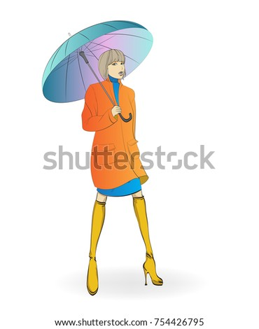Autumn-winter 2018. Beautiful girl in a coat with an umbrella, against the background of a rain with snow. Autumn fashion model.