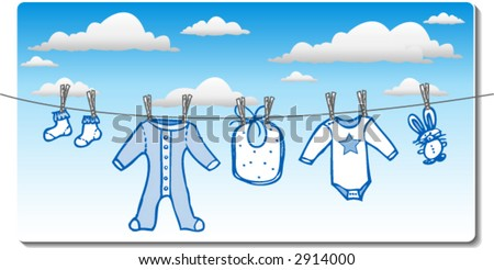 Baby boy clothes drying on clothes line