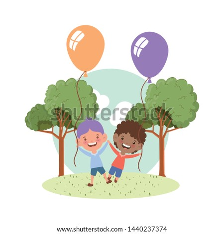 baby boys smiling with helium balloons in hand